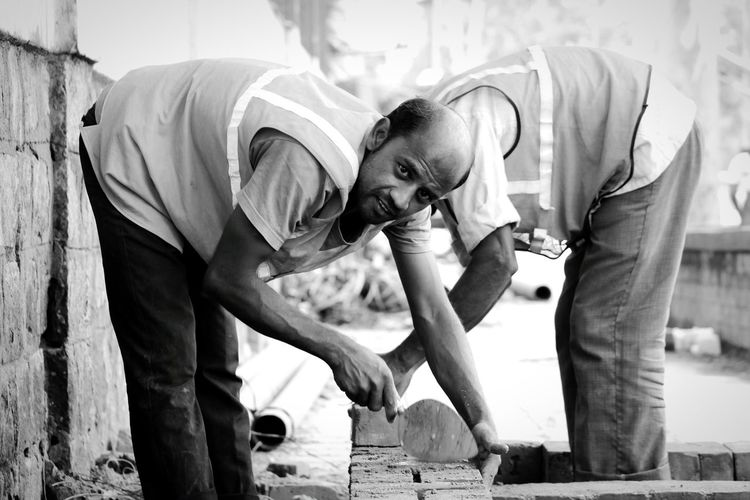 Portrait of construction worker on street