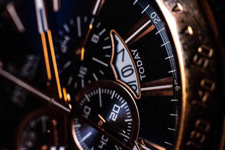 Close-up of clock on mirror