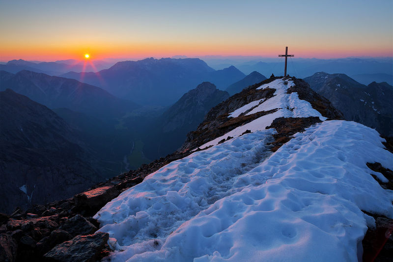 Peak of the rising sun EyeEmNewHere Cross Hiking Karwendel Morning Mountaineering Nature Alpine Landscape Alps Beauty In Nature Dawn First Light Landscape Mountain Mountain Peak Mountain Range No People Non-urban Scene Outdoor Scenics - Nature Snow Sunrise