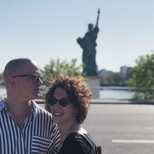Couple Standing Against Statue Of Liberty
