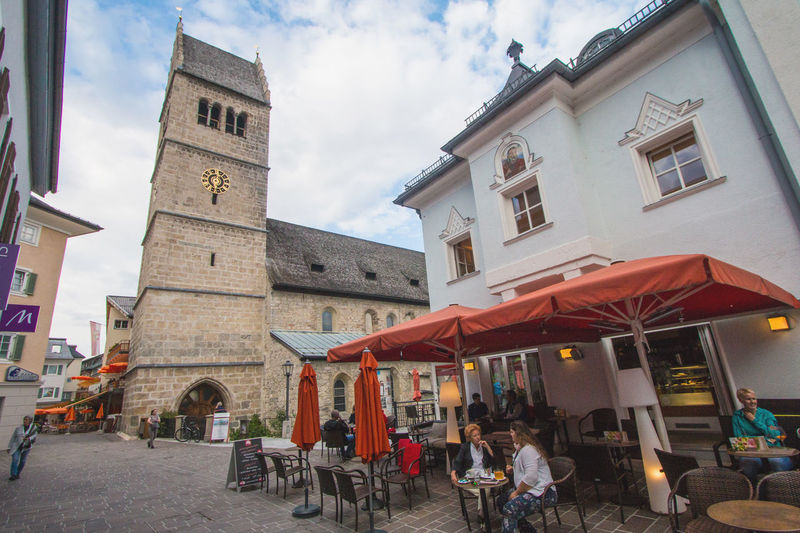 St Hippolyte Church in Zell Am See town in Austria. Church Architecture Built Structure Cafe Clock Outdoors Place Of Worship Restaurant St. Hippolyte Street Tower Town