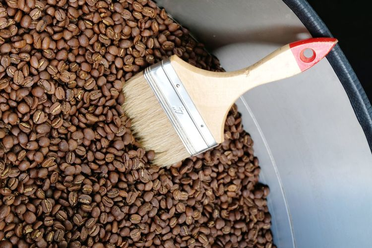 Paint brush on many coffee beans Latte Coffee Beans Paint Brush Close-up
