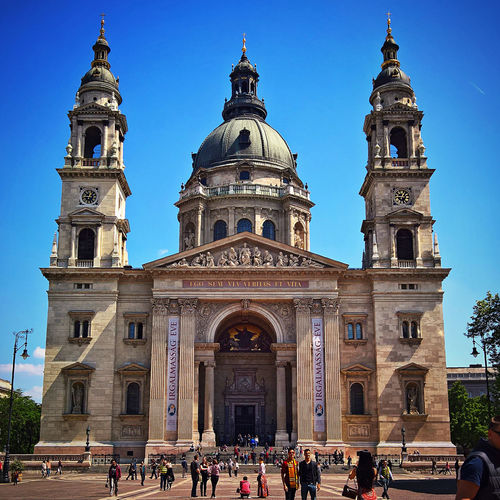 Architecture Bazilika Blue Budapest Built Structure Church Church Day Famous Place Hungary Large Group Of People Leisure Activity Lifestyles Low Angle View Mixed Age Range Outdoors Place Of Worship Religion Sky Spirituality Spring Szent István Bazilika Tourism Tourist Travel Destinations