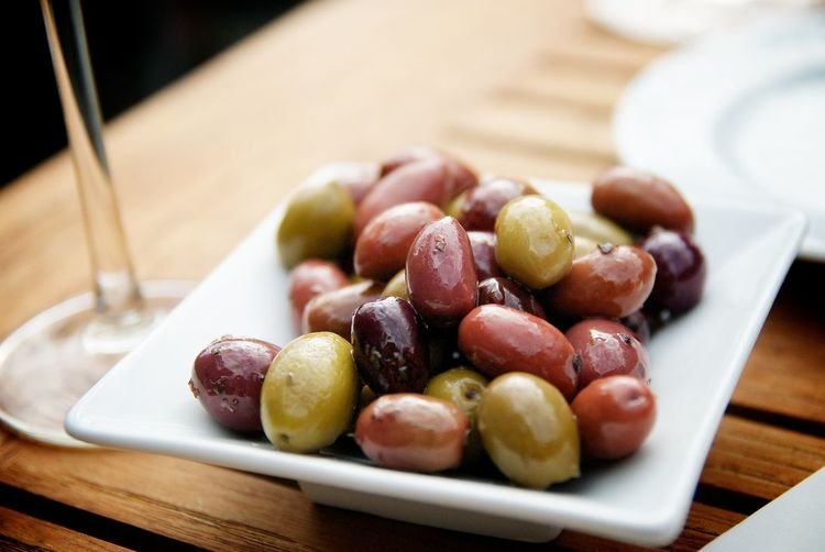 Close-Up Of Pickled Olives In Tray On Table