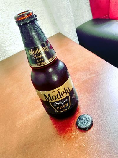 Beer Time Relaxing Beer Drink Alcoholic Drink Modelo Negra Indoors  Bottle Still Life Shiny Container Fashion High Angle View Close-up Alcohol Table Refreshment No People Beer Bottle