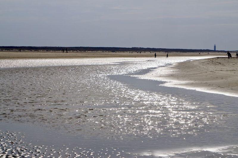 Water Sea Beach Land Sky Beauty In Nature Scenics - Nature Horizon Sand Idyllic Non-urban Scene Outdoors Horizon Over Water Day Salt Flat Incidental People Nature Tranquil Scene Tranquility Sunlight