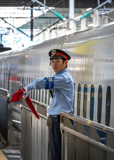 One Person Men Real People Railing Three Quarter Length Occupation Protection Security Safety Standing Side View Looking Away Clothing Males  Architecture Day Protective Workwear Holding Built Structure Outdoors Uniform