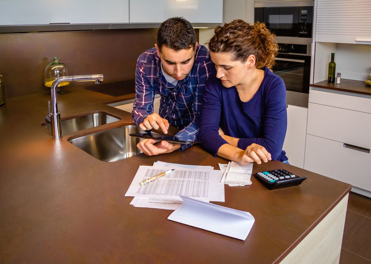 Couple discussing budget at home
