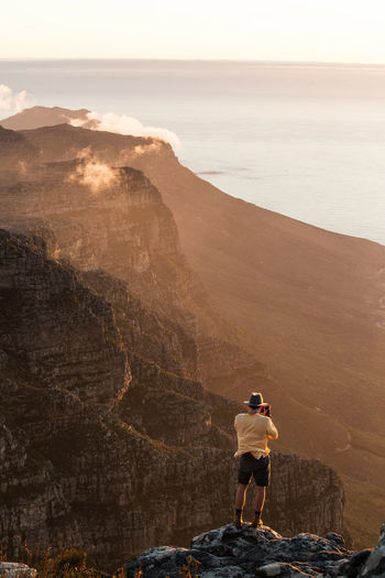 Adventurer Cape Town Cape Town, South Africa Explore Explorer Leisure Activity Lifestyles Lion's Head Mountain Mountain Range Rock Formation South Africa Sunset Table Mountain Travel Destinations Travel Photography