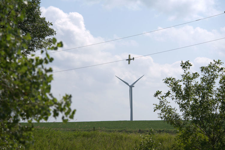 Windmill, Aircraft, Crop Duster,,daytime, No People, Craft Looks To Be On A Wire,