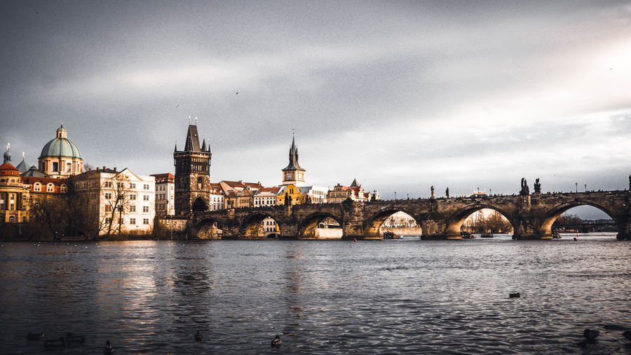 Architecture Built Structure Building Exterior Water Sky Building Cloud - Sky Waterfront Religion Place Of Worship River City Spirituality History Travel Destinations Nature Belief The Past No People Outdoors Government Arch Bridge Spire  Prague Prague Czech Republic