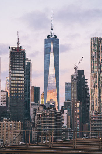 Low angle view of one world trade center against sky in city