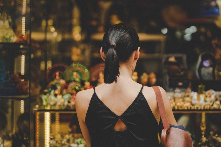 Rear view of woman doing window shopping