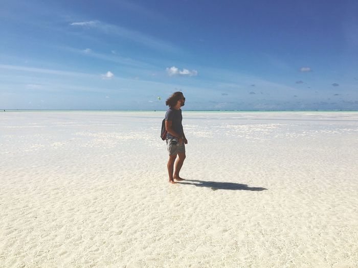 Breathing Space Zanzibar Tanzania Jambiani Beach Sea Sand Beach Water Lowtide  Nature Sky Full Length One Person Beauty In Nature Scenics Real People Tranquility Leisure Activity Outdoors Day Travel Travel Destinations Lonelyplanet Endlessness Lost In The Landscape