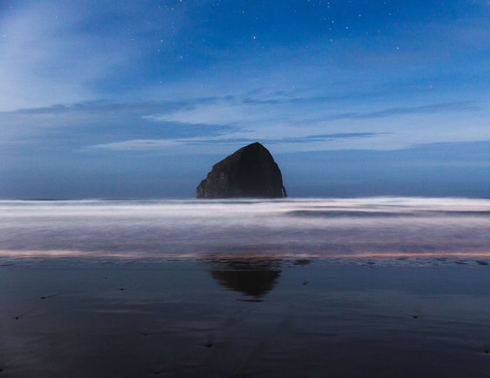 Long-exposure night shot of Haystack Rock on Cape Kiwanda Beach in Pacific City, Oregon. Cape Kiwanda Nightphotography Oregon PNW PNWonderland Pacific Northwest  Pacific Northwest Beauty Pacific City Beach Beauty In Nature Day Horizon Over Water Iceberg Nature Night No People Outdoors Pacific City Oregon Sand Scenics Sea Sky Tranquil Scene Tranquility Water