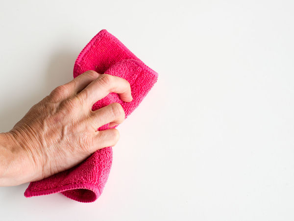 Hand using cloth to wipe Adult Body Part Close-up Copy Space Cut Out Finger Hand Holding Human Body Part Human Finger Human Hand Human Limb Indoors  Nail One Person Pink Color Real People Red Studio Shot White Background Women