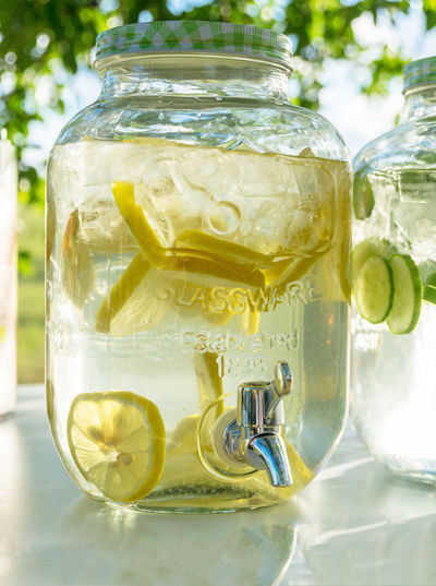 glass with lemonade and lemon slices Cool Thirsty  Citrus Fruit Close-up Cold Temperature Container Day Drink Focus On Foreground Food Food And Drink Freshness Fruit Glass Glass - Material Healthy Eating Lemon No People Outdoors Refreshment SLICE Still Life Summer Table Transparent