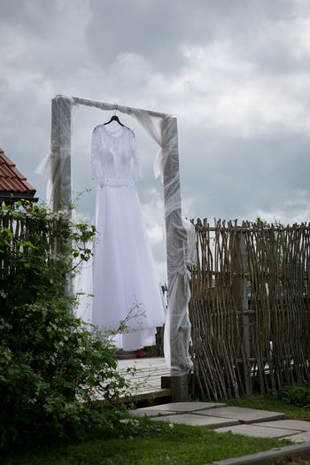 wedding dress Backgrounds Beauty Bridal Bride Dress Business Finance And Industry Cloud - Sky Day Enjoying Life EyeEm Best Shots Fashion Fence Fog Gate Holiday Love Material Nature No People Outdoors Rural Scene Sky Wedding Around The World Wedding Day Wedding Dress Wooden