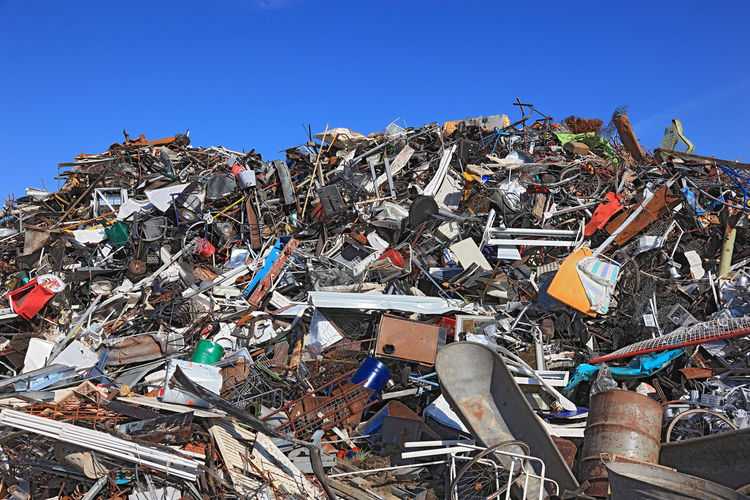 Scrap metal waste dump on a scrap yard, recycling company Industry Iron Abandoned Abundance Clear Sky Day Destruction Environmental Issues Garbage Garbage Dump Heap Junkyard Large Group Of Objects No People Outdoors Pollution Raw Materials Recycling Recycling Center Scrap Scrap Metal Scrap Yard Sky Waste Management