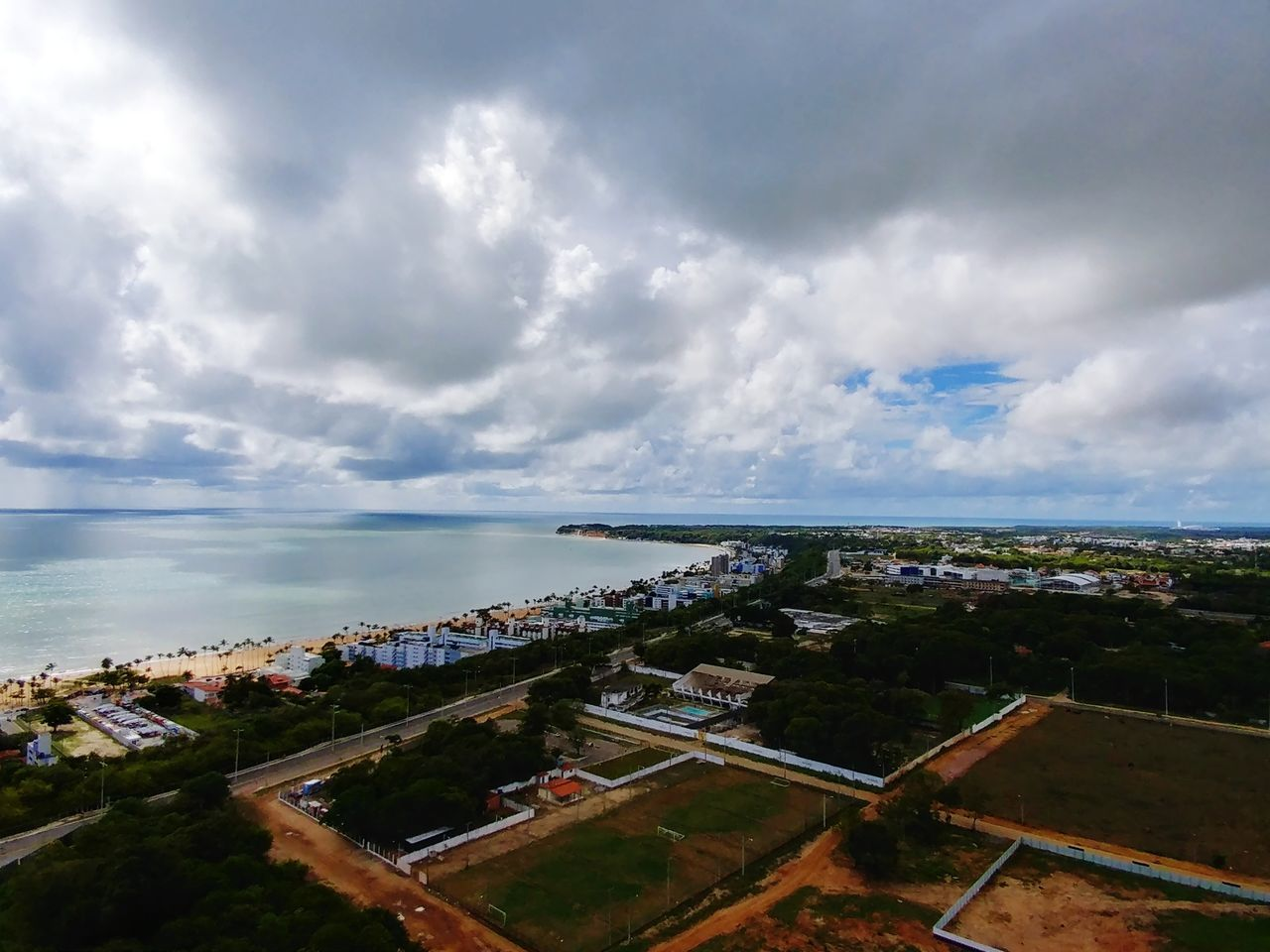 cloud - sky, architecture, built structure, sky, building exterior, sea, horizon over water, water, cityscape, high angle view, day, outdoors, city, no people, town, residential building, nature, scenics, tree, residential, beauty in nature