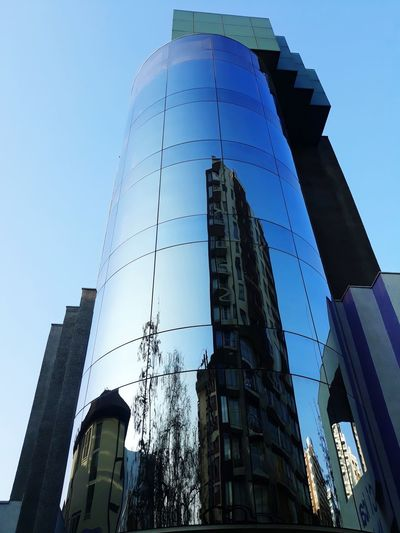 Reflection City Tree Clear Sky Business Finance And Industry Modern Architecture Building Exterior Sky Built Structure Tower Office Building Financial District  Tall - High Skyline Cityscape