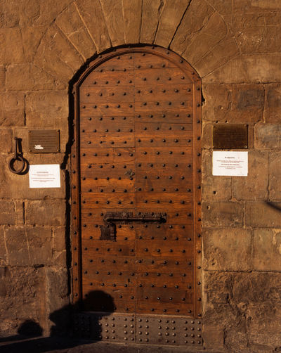 Entry Arch Day Florence Fortified Structure Heavy Wooden Door Midieval Town Outside Stone Wall