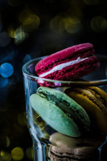 Close-Up Of Multi Colored Macaroon In Glass Jar