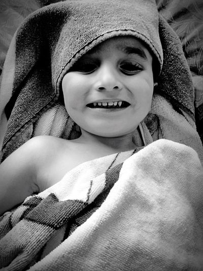 Low Angle Portrait Of Boy Wrapped In Towel