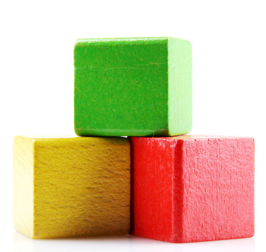 Close-up of multi colored wooden blocks against white background
