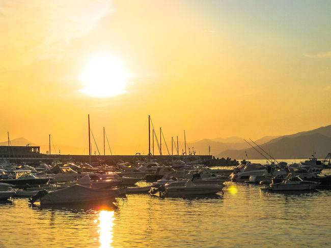 Scenic harbor of Sestri Levante at sunset with its famous Bay of Silence and its boats. Province of Genoa in Liguria, Italy. City Genova Harbour Sestri Levante Skyline Aerial View Baia Del Silenzio Bay Beach Beauty In Nature Boats Cistyscape Fishing Italy Liguria Marine Nature No People Outdoors Scenics Sea Seascape Ships Silence Sky Sun Sunlight Sunset Town Tranquil Scene Tranquility Village Water Waterfront