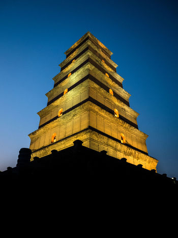 Great Wildgoose Pagoda, Xi'an, China. The park closes at 6pm so if you want to take a nighttime photo, you will have to go in winter and stay there until the last minute. Ancient Architecture Blue Building Exterior Built Structure China China Beauty Chinese Culture Chinese History Clear Sky Cultures History Low Angle View No People Outdoors Pagoda Place Of Worship Religion Temple Travel Destinations Travel Photography Xi'an 大雁塔 西安