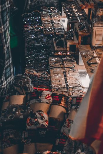 High angle view of eyeglasses for sale at night market