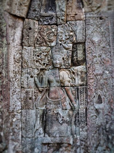 Khmer carving in temple, Angkor Archaeological Park Cambodia Khmer Culture Khmer Temple Carving Temple Carving - Craft Product Sculpture No People Religion Bas Relief Close-up Architecture Ancient Civilization