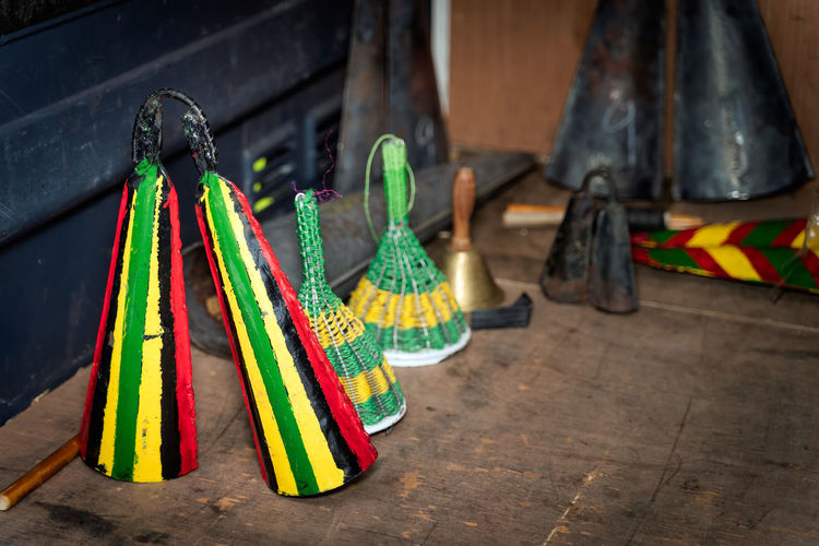 Close-up of multi colored shoes hanging on floor