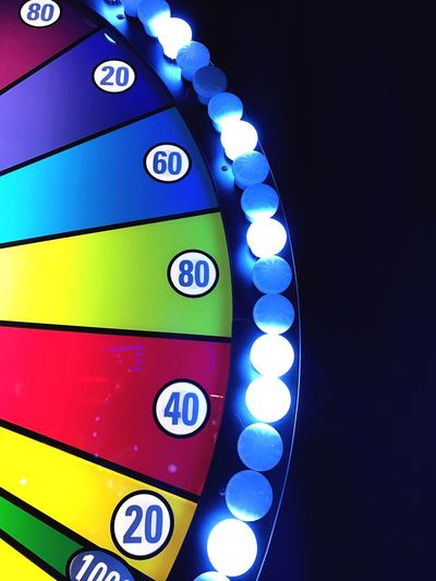 Multi Colored No People Illuminated Rainbow Colors Text Numbers Lines, Shapes And Curves Lighting Equipment Light Bulbs Semi Circle Circles Ovals Game Fairground Carnival Fun Prizes Are Coming! Jackpot Close-up Night