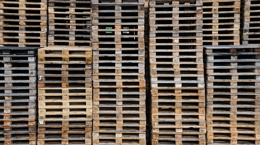 Full frame shot of stacked pallets