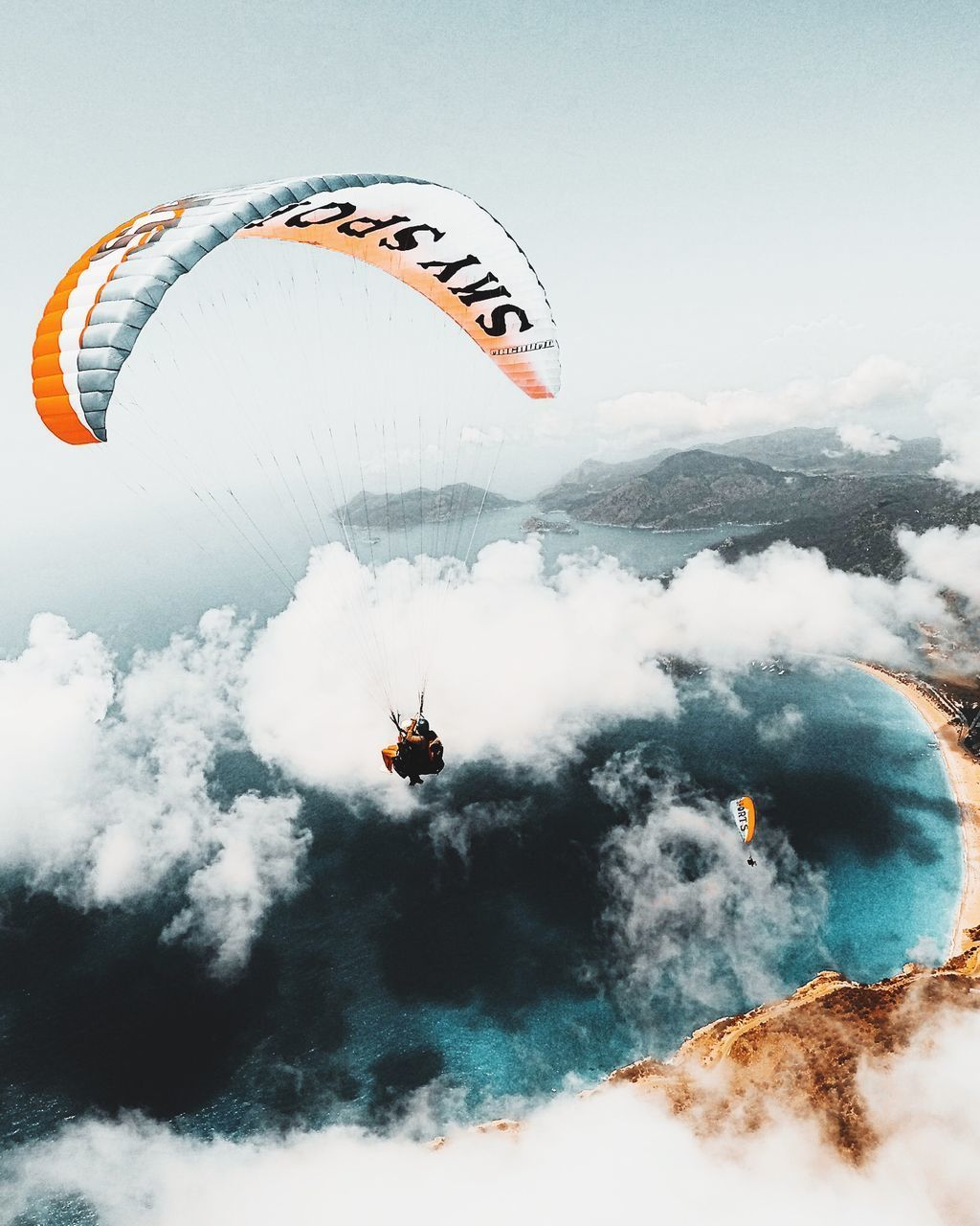 AERIAL VIEW OF PERSON PARAGLIDING