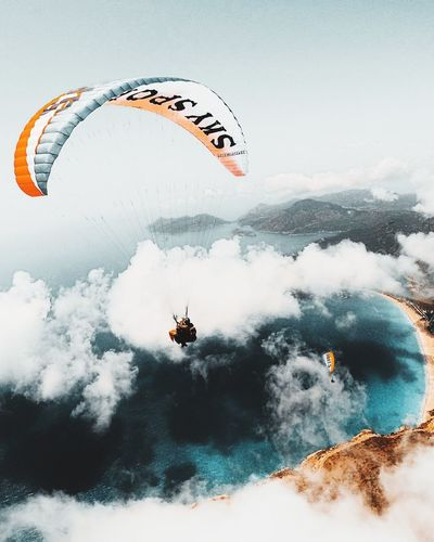 Aerial view of person paragliding against sky