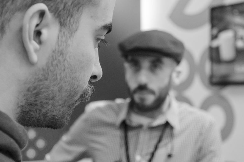 27 January 2019: Beverage food and tourism festival, Blurry guy with traditional cap and beard Young Men Beard Young Adult Real People Facial Hair Lifestyles Men People Mid Adult Men Headshot Portrait Two People Focus On Foreground Leisure Activity Indoors  Looking Mid Adult Front View Close-up Contemplation