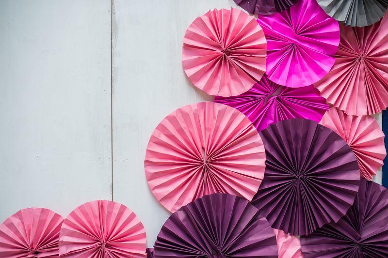Close-up of multi colored umbrella against wall