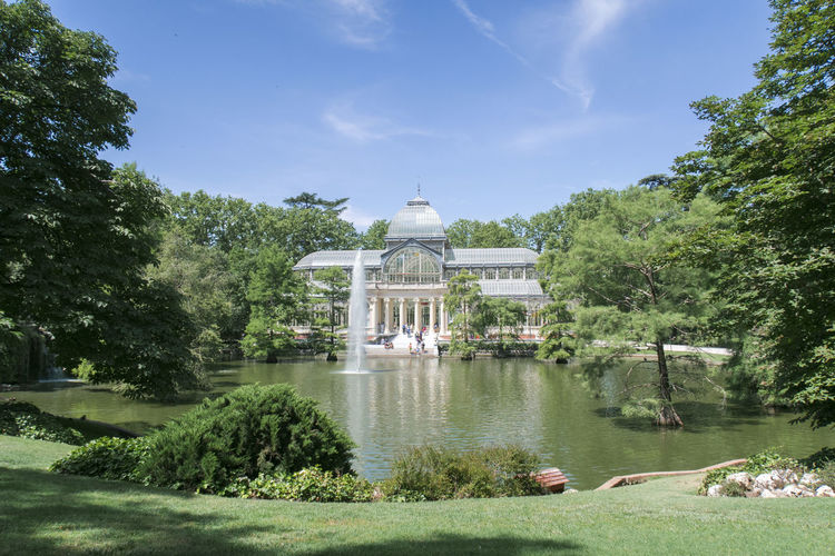 Architecture Building Exterior Built Structure Crystal Palace Day Fountain Glass Palace Grass Growth Lake Madrid Spain Nature Nature Outdoors Palacio De Cristal Park Parque Del Retiro Plant Sky SPAIN Travel Destinations Tree Trees Water