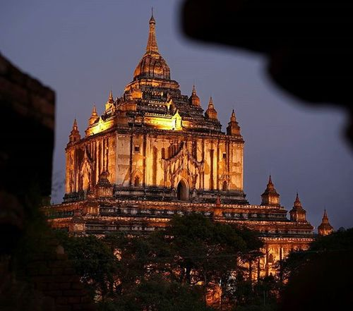 Yet Another Bagan Sunset It's hard to get bored with a sunset around here. Thousands of temples dot the landscape, spreading out in every direction you turn But after the sun goes down and people rush down there high spot on the temple preparing to race back to their guesthouse and get some dinner into their belly, what you want to do is stay Stay for the shifting colors in the sky as they continue to turn after the sun has dipped over the horizon. Stay for the lights that shine on the biggest and most important temples, making them glow Just make sure you don't forget your headlamp. Those stairs coming down from the temple can be sketchy! Myanmar Burma ThisMyanmarLife Ananda Bagan