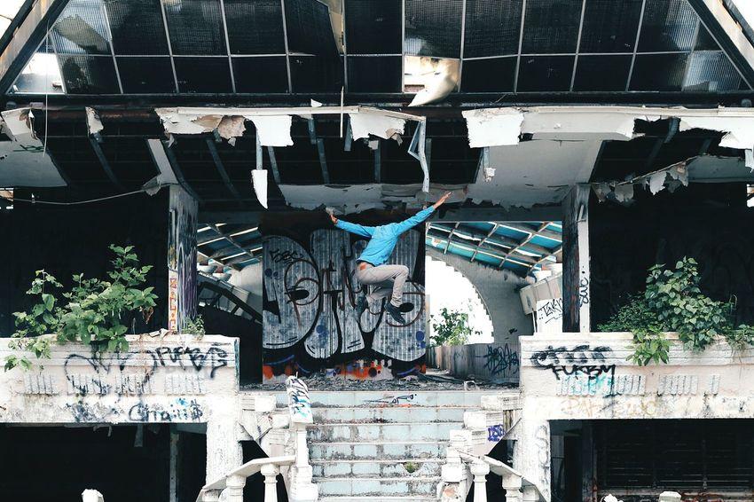 Origin of symmetry. Jump Jumpshot Old Buildings Ruins Street Graffiti Symmetrical Symmetry The Architect - 2016 EyeEm Awards