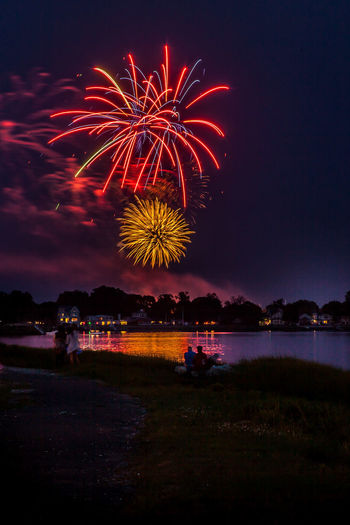 Low angle view of sky illumed with fire crackers