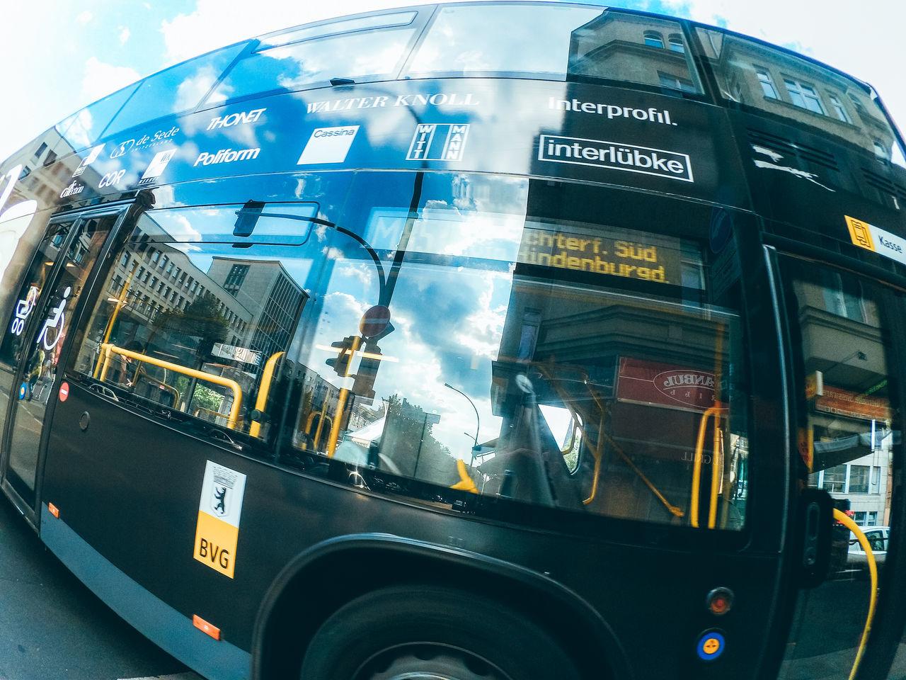 transportation, mode of transport, text, land vehicle, communication, public transportation, bus, day, outdoors, no people, sky