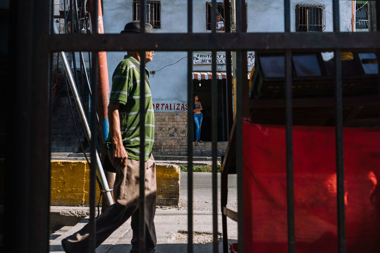 Hortalizas. Architecture Building Exterior Real People Built Structure Men Day Window People Walking City Standing Sunlight Clothing Three Quarter Length Outdoors Safety Occupation Protection Security Uniform EyeEm Best Shots EyeEm Selects Streetphotography Street Photography Streetphoto The Street Photographer - 2019 EyeEm Awards