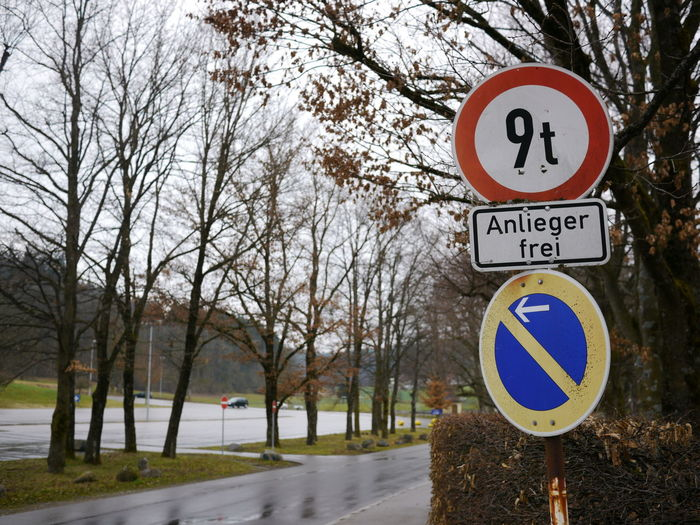 Trafficsign in south Germany Allgäu Guiding Traffic Bare Tree Communication Day Guidance Guide Nature No People Outdoors Road Road Sign Sky Speed Limit Sign Traffic Sign Transportation Tree