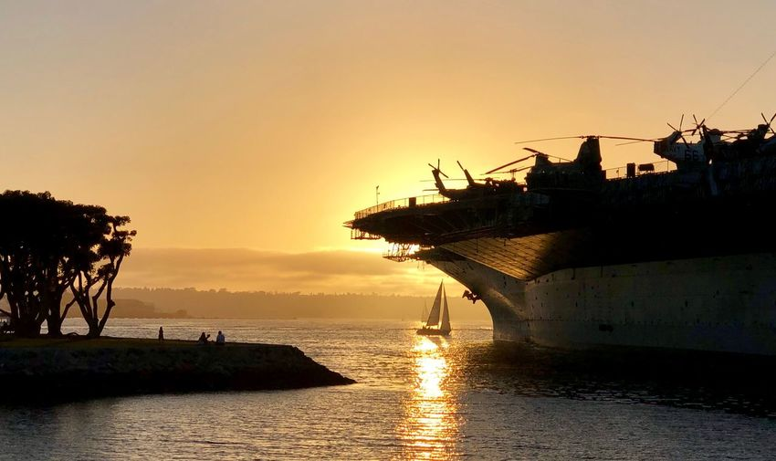 USS Midway, Museum, San Diego, California, Aircraft Carrier, Ship, Memorial, San Diego Sunset Water Sky Sea Silhouette Nautical Vessel Nature Mode Of Transportation Transportation Tranquil Scene Sunlight Idyllic Plant No People Scenics - Nature Orange Color Beauty In Nature Tranquility Tree Reflection