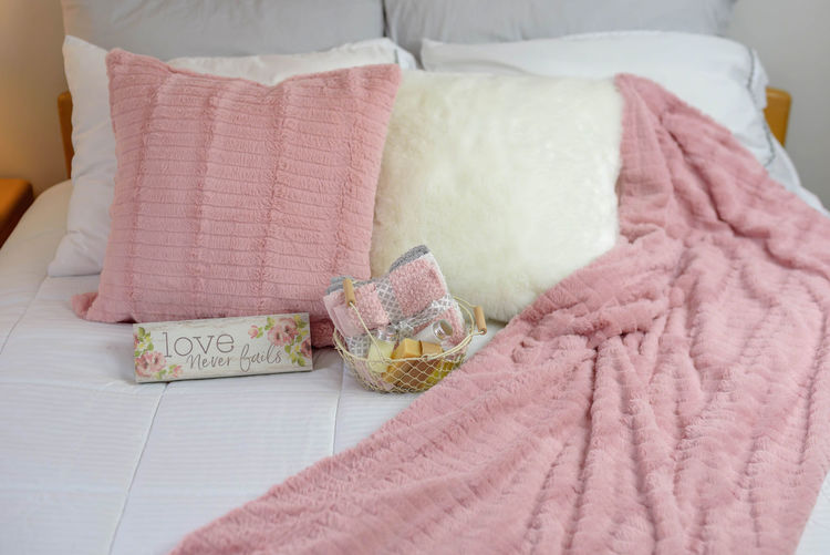 "Cozy and relaxing neutral decor bedroom with pink accents and sign that says ""Love never fails"" Decor Home Love Morning Pink Room Room Decor Sign Soft Bed Bedding Bedroom Blanket Comfort Cozy Guest Room Home Interior Indoors  LOVE NEVER FAILS Message Pink Color Relaxation Textile Texture Words"