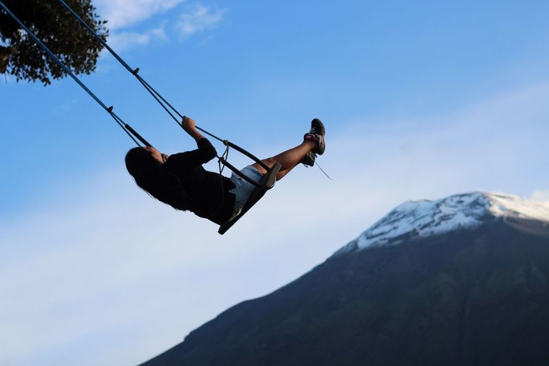 Breathtaking Overcoming View Action Adventure Baños Casa En El Arbo Climbing Day Ecuador Excitement Full Length Height High Mountain Mountains And Sky Nature One Person Outdoors People Scenery Sky Snowcapped Mountain Swing Swinging In A Tree Treehouse View From Above Young Adult